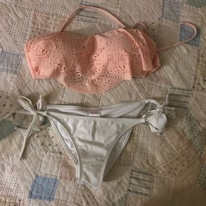 Peach bandeau bikini top and white bikini bottoms
